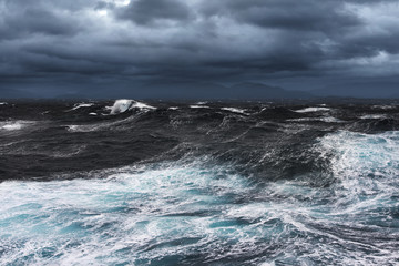 Storming Seas and Mountains in the Horizon