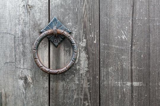 The old door handle on a wooden door