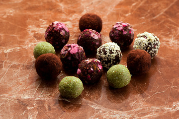 Raw homemade candy truffles on a marble background. Organic Healthy Product Gluten free