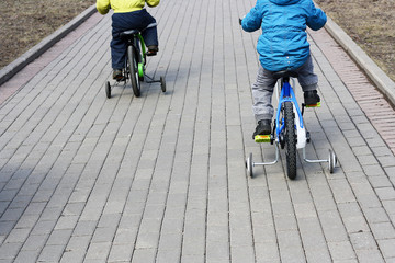 Children ride bicycles.