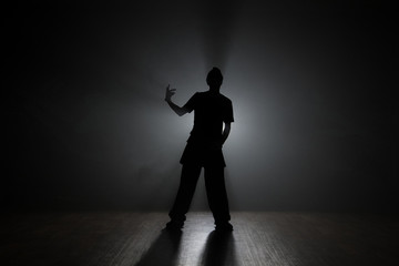Hip Hop Dancer Posing Backlit