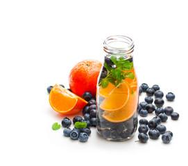 detox  organic blueberry and orange drink isolated on white