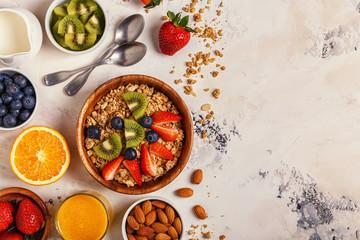 Healthy breakfast - bowl of muesli, berries and fruit