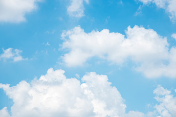 Beautiful white fluffy clouds in the blue sky. Fresh natural in day time. Use for nature background.