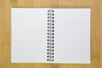 Opening note book on desk