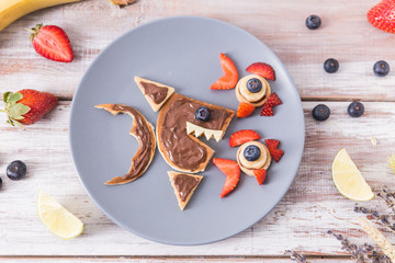 Top view on pancakes in the shape of fish