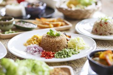 Asian food. Rice Seasoned With Shrimp Paste (Khaao Khlook Gabpi) on wooden background