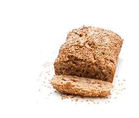 Homemade  wholemeal rye bread with flax seeds isolated on white