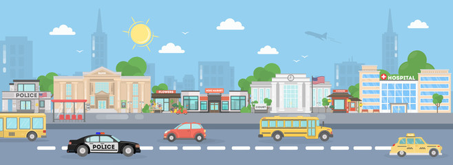 America city street. Urban landscape. School bus, poica car, stores and american flags.