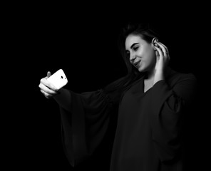 Pretty young girl uses smartphone Grayscale