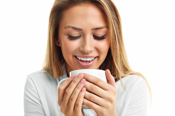 Adult woman drinking cup of tea coffee isolated over white