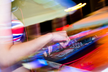 Dj mixing in nightclub at party.