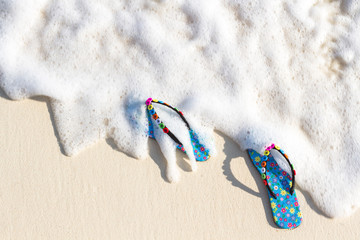 Blue women's beach shoes, with white sand, blue sea and sky. Thailand, Similan Islands.