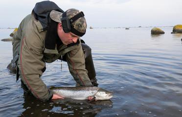 Sea angler release big sea trout