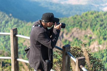 Photographer taking photo of amazing landscape.