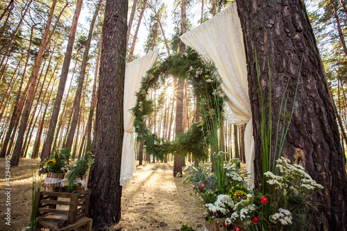 Rustic Wedding Arch.Wedding Arch And Decorations For Rustic Wedding Ceremony Stock