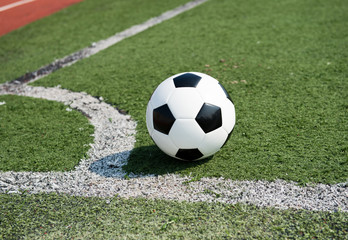 soccer ball on stadium grass line.
