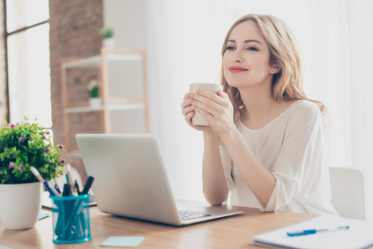Happy pretty cute woman working with computer enjoying coffee