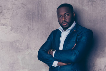 Portrait of successful  handsome afroamerican man in stylish suit crossed hands