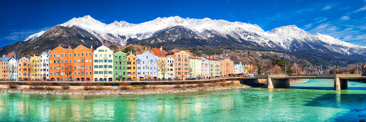 City scape in Innsbruck city center with beautiful houses, river Inn and Tyrolian Alps, Austria, Europe. Wall mural