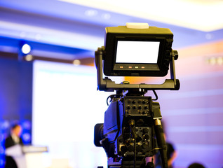 Live broadcasting, television operator with camera.