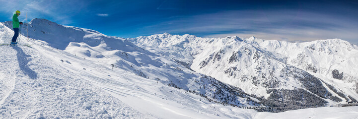 Man enjoying the stunning view before freeride skiing in famous ski resort in Tyrolian Alps, Zillertal, Austria