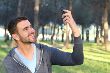 Man taking a selfie in the park
