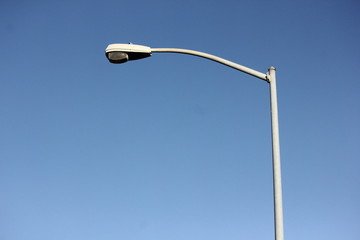 Street light pole on a blue sky