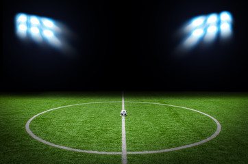 Soccer Football on the Green with bright spotlights