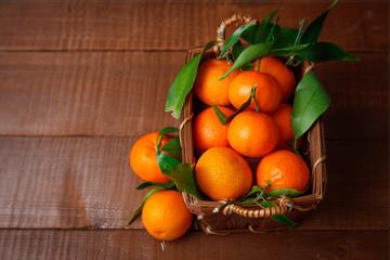 Fresh tangerines in old box