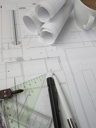 Architectural Drawing Materials coffee on the table,the project, drawing materials,architectural