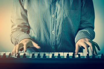 closeup hand of woman playing piano