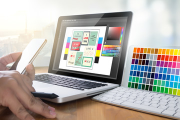 Creative Designer Graphic at work. Color swatch samples, Illustrator Graphic designer working digital tablet and computer