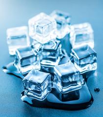 Ice cubes over dark background