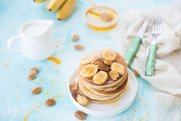 The American pancakes with honey, bananas and nuts