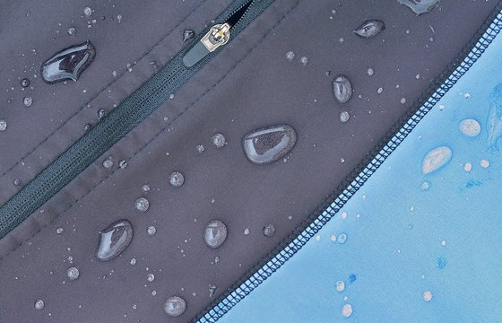 Detailed view of  softshell jacket with water drops, zipper and seams.