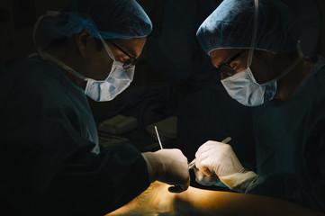 Surgeons making an Achilles tendon operation