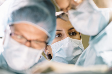 Surgeons doing surgery in the operating room