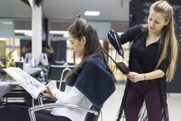 Beautiful women in hair salon doing her hair style
