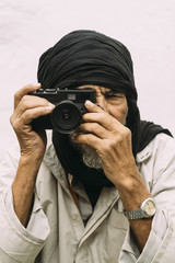 Close up of a man taking picture with camera