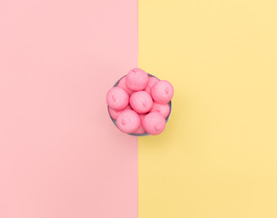 photo of tasty pink marshmallows on the plate on the wonderful background in pop art style