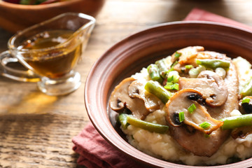 Bowl with tasty chicken marsala on table