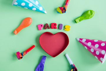 photo of colorful letters, heart shaped box and birthday decorations on the wonderful green background