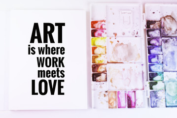 """Inspirational quote """"Art is where work meets love"""" on blurred background with vintage filter"""