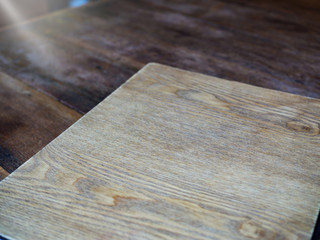 Cover paper or book, empty space, on wood table