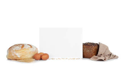 Sheet of paper with space for text and bread on white background