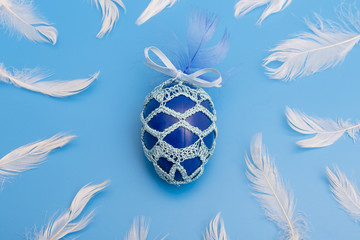 easter egg painted and dressed in feathers