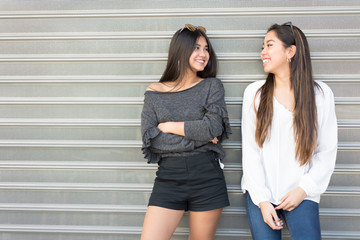 Two friends posing on the street