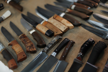 Variety of knives on exhibition, closeup
