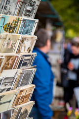 People selling old retro vintage postcards on the streets of Paris, France.